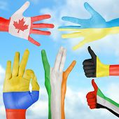 Flag of different countries painted on hand