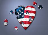 USA flag heart in puzzle pieces