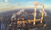 stock photo of chp  - Territory of power plant with high chimneys at winter - JPG