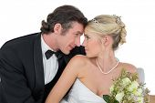 Loving newly wed couple with head to head looking at each other at home
