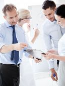 business concept - friendly business team having discussion in office
