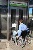 Wheelchair User On A Defect Lift