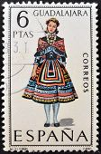 A stamp printed in Spain dedicated to Provincial Costumes shows a woman from Guadalajara