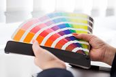 foto of interior decorator  - Graphic designer working with pantone palette in studio