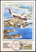 stamp shows A Fokker F28 in flight over of Madang township in the Madang Province
