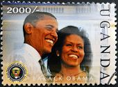 A stamp printed in Uganda shows Barack Hussein Obama and Michelle Obama