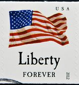 stamp shows the image of the USA Flag Liberty USA forever