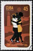 A stamp printed in Cuba dedicated to popular dances shows son dance