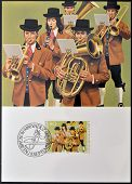 stamp dedicated to traditional costumes shows Brass Band at Mauren