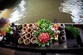 Fresh ingredients in a boat at Taling Chan floating market, Thailand