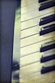 Close up of piano keys, vintage photo