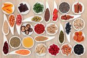 Healthy super food selection over oak wood background
