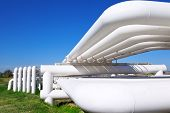 foto of gas-pipes  - Industrial pipe with gas and oil and water on a background of blue sky - JPG