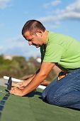 Man On The Roof Fastening Bitumen Roof Shingles