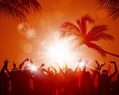 stock photo of rave  - party crowd raving among palms before sunset - JPG