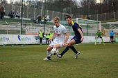 KAPOSVAR, HUNGARY - MARCH 16: Kink Tarmo (in white) in action at a Hungarian Championship soccer gam