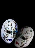 Two Decorated Mask Isolated On Black Background.
