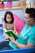 Asian Dad Reading A Fairytale