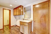 Empty Bathroom With Wooden Cabinets