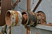foto of pulley  - A worn out  old threshing machine pulley  system  indicate hours of usage - JPG