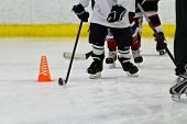 pic of hockey arena  - Youth ice hockey team doing drills during practice - JPG