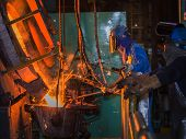 foto of production  - matallurgic production production of cast iron metal melting - JPG