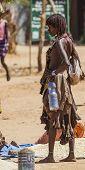 Hamar Woman Seller At Village Market.