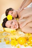 Couple Receiving Shoulder Massage At Spa