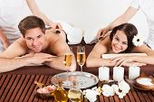Happy Couple Receiving Shoulder Massage At Beauty Spa