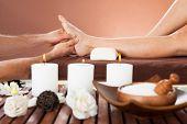 Therapist Massaging Customer's Foot At Beauty Spa