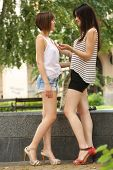 Two teenagers talking on the street