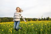 jumping happy girl outdoor