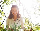 Portrait Of Happy Young Woman In Foliage