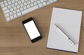 Wooden Desk Keyboard Smartphone And Notepad