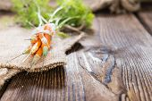 Carrot Injection On Wooden Background