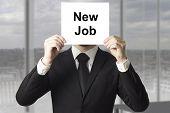 Businessman Hiding Face Behind Sign New Job