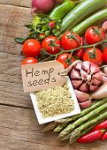 Raw Organic Hemp Seeds With A Label And Vegetables