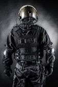 picture of anti-terrorism  - Spec ops soldier on black background shot from behind - JPG