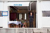 San-sebastian. Little Harbor Fish Restaurant On The Ashore