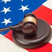 Wooden Judge Gavel And Soundboard Laying Over Usa Flag - Closeup Studio Shoot