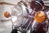 Close Up Of A Motorcycle Headlight With Blinker Light
