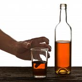 Glass And Bottle Of Brandy Isolated On The White