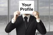 pic of incognito  - businessman hiding face behind sign your profile - JPG