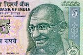 pic of indian currency  - Closeup macro view of Mahatma Gandhi on an Indian currency note - JPG
