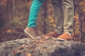 stock photo of couples  - Couple Man and Woman Feet in Love Romantic Outdoor with Autumn season nature on background Fashion trendy style - JPG