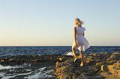 Young Girl Is Walking Trough Coast