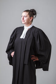 pic of toga  - woman in her thirties wearing a black toga canadian lawyer toga looking to the left - JPG
