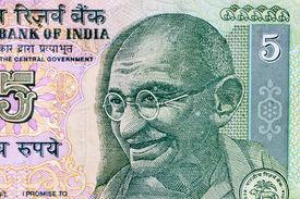foto of gandhi  - Closeup macro view of Mahatma Gandhi on an Indian currency note - JPG
