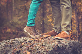 stock photo of foot  - Couple Man and Woman Feet in Love Romantic Outdoor with Autumn season nature on background Fashion trendy style - JPG