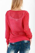 Young Slim Blond Woman In Red Net Sweater And Jeans Closeup From The Back Isolated